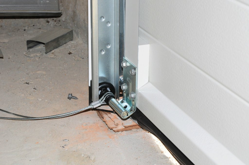 Expert broken cable repair and replacement services for for Garage door services schertz tx